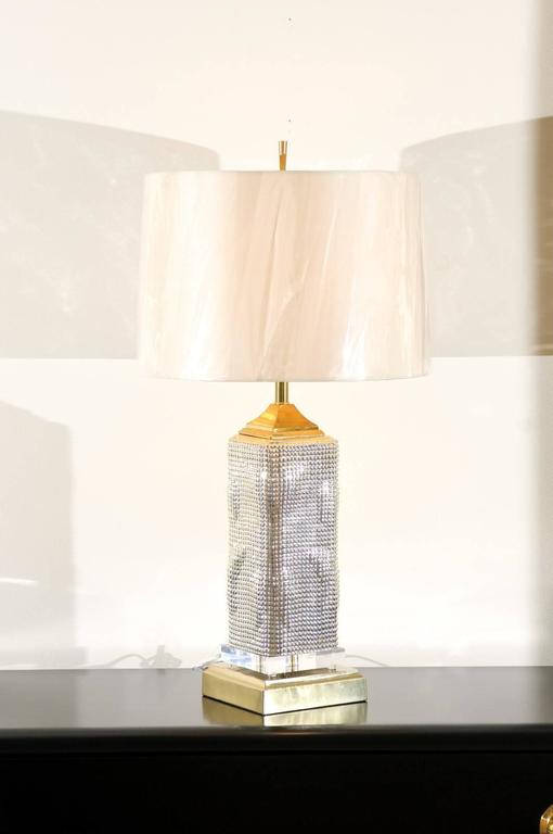 An absolutely fabulous and unique pair of custom-made Skyscraper lamps. Vintage blown mercury glass vessels with beautiful color, sheen and texture. Vintage solid brass accents along with a new museum quality Lucite plinth. Exquisite jewelry!