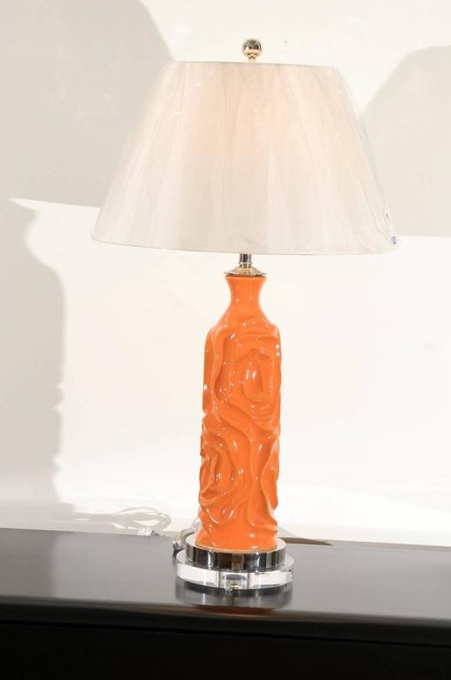 An exceptional pair of ceramic vessels as custom lamps. Beautiful form with excellent texture and vivid color. Fabulous weight and craftsmanship. Stunning jewelry! Excellent restored condition. Wired using clear cord; new nickel three-way sockets
