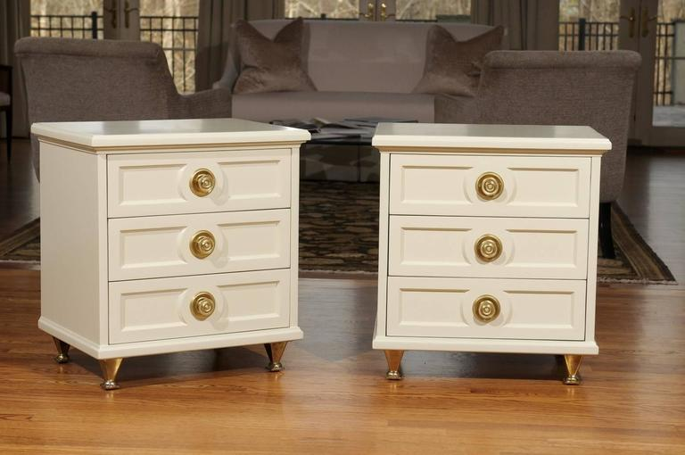 An exceptional pair of end tables or nightstands by American of Martinsville, circa 1960. Heavy, expertly crafted mahogany case construction with exquisite detail. Fabulous solid brass hardware and feet. Stunning jewelry! Excellent restored