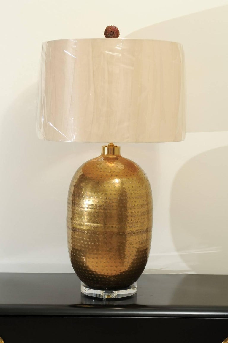 A stunning pair of large-scale forged brass lamps, circa 1970. Beautiful textured form atop a thick Lucite base. Custom carved stone finials ice the cake. Exceptional quality and craftsmanship. Brass with lovely patina. Exquisite jewelry! Excellent