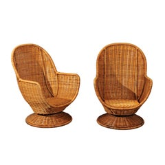 Fabulous Pair of Wicker Egg Swivel Club Chairs, circa 1975