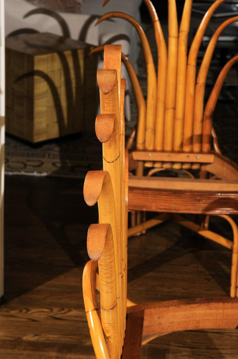 An absolutely Majestic pair of custom-made palm frond style dining chairs, circa 1950. Exceptionally conceived and crafted rattan and hardwood construction with a magnificent back detail. Stout, rigid and comfortable. These pieces were likely