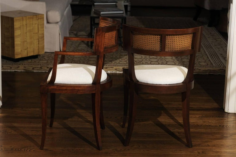 The rarest of the rare: An exceptional, meticulously restored set of ten (10) cane back Klismos dining chairs by Baker Furniture, circa 1958. This design is routinely attributed to the esteemed Michael Taylor. Expertly crafted solid cherry