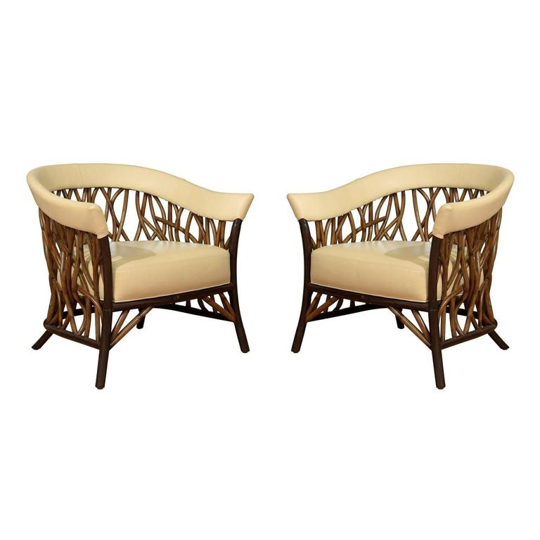 Stunning Pair of Rattan Club Chairs in Parchment Leather For Sale