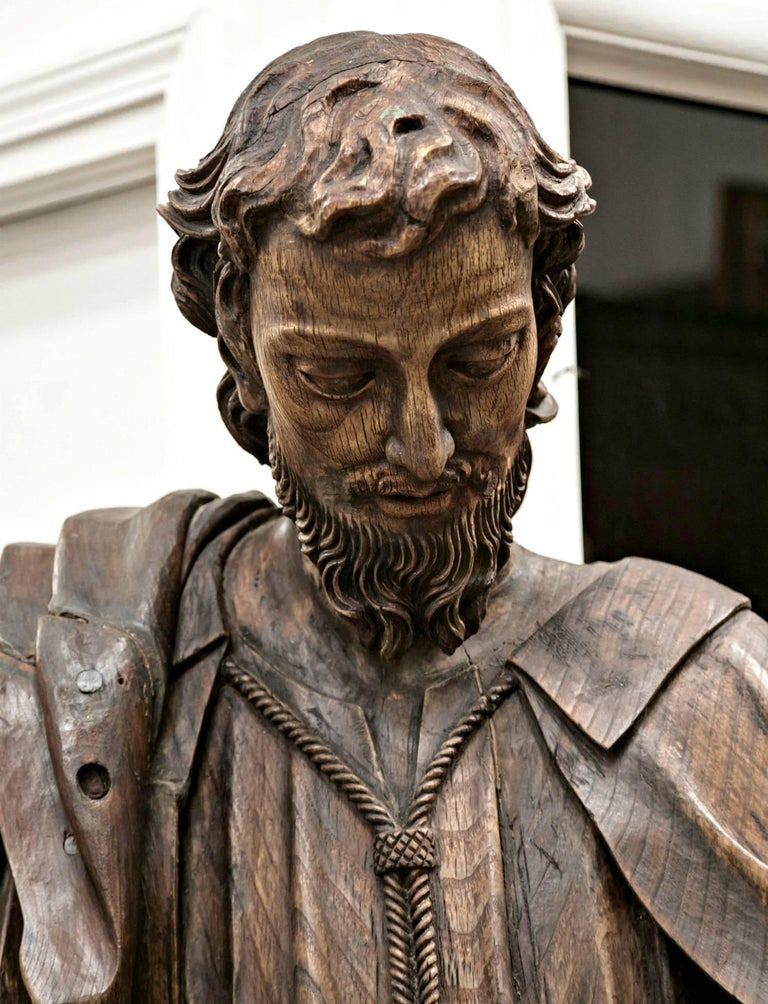 Magnificent wood statue of St. Joseph, hand-carved of solid oak with intricate draped cloths and a beautiful, lifelike facial expression. A rare and exquisite work of 18th century religious art, this life-size statue comes from a small village
