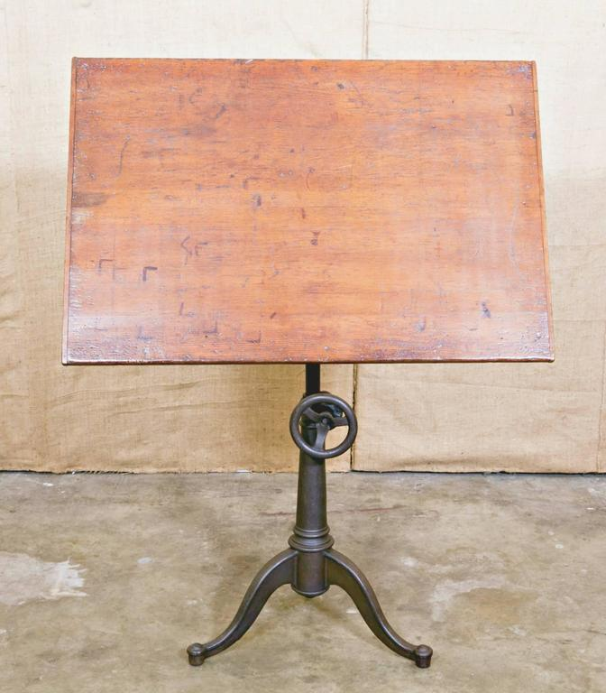 This vintage drafting table by hamilton is no longer available - Vintage Cast Iron Articulating Tripod Base Drafting Table