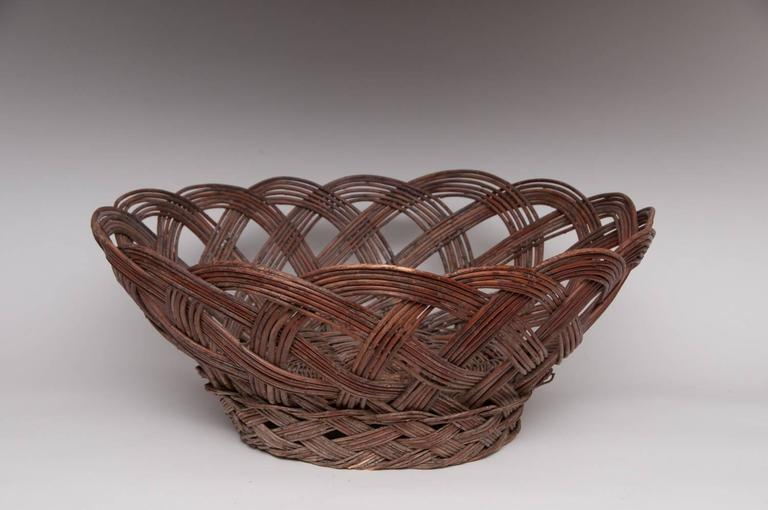 """Region / Tribe: Southwest / Jemez Pueblo (?)  circa 20th century  Material: Willow rod  Dimension:  Left: L. 15"""" x H. 6""""  Right: L. 26"""" x H. 11""""  Condition: Excellent, no restoration  Comments: Plaited wicker baskets are also made by"""
