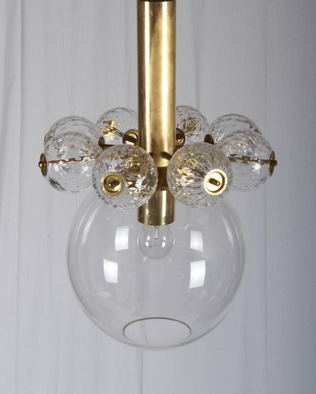 Brass construction with one large and eight small handblown crystal balls fitted with one E27 bulb, made by Kamenicky Senov in the 1950s. Perfect vintage condition, the total length can by changed on request.