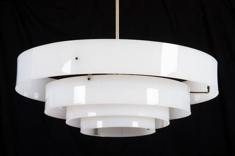 Four white plastic rings fitted with one E27 sockets.