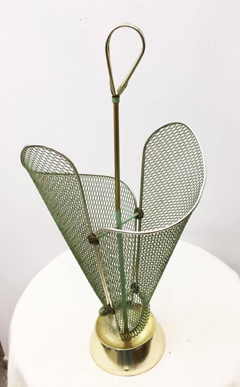 Brass construction with perforated green painted steel elements on a heavy cast iron foot. Made in Italy in the 1950s.
