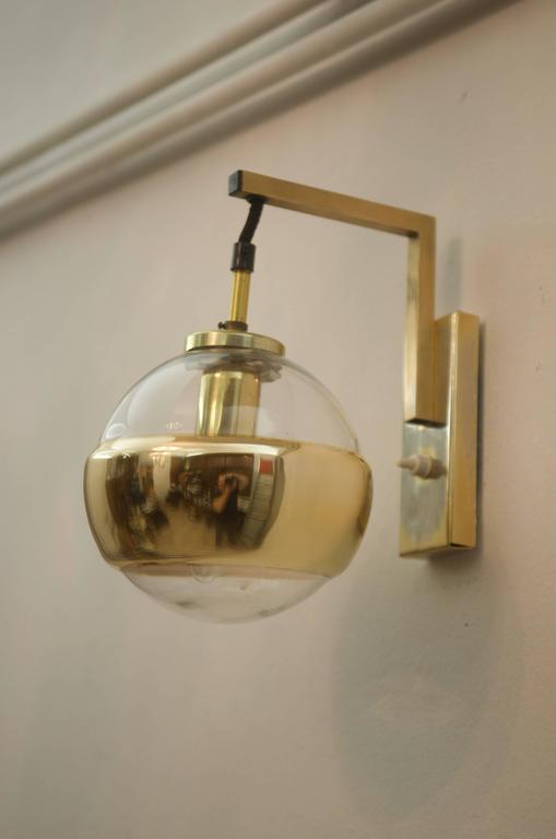 Steel frame with glass globe with gold strip fitted with one e14 socket. Made in Germany by Peill & Putzler in the 1960s.