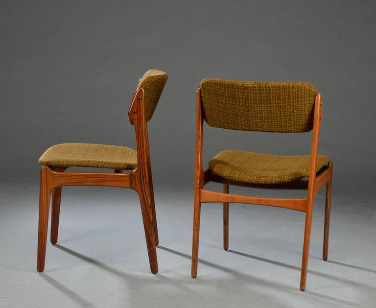 Erik Buck. Four chairs with rosewood frame, seats and top rails upholstered in wool. Produced by Oddense Maskinsnedkeri A/S, model OD 49. Perfect original condition but a new upholstery is on request possible. Measures: H. 79 SH. 45 cm.