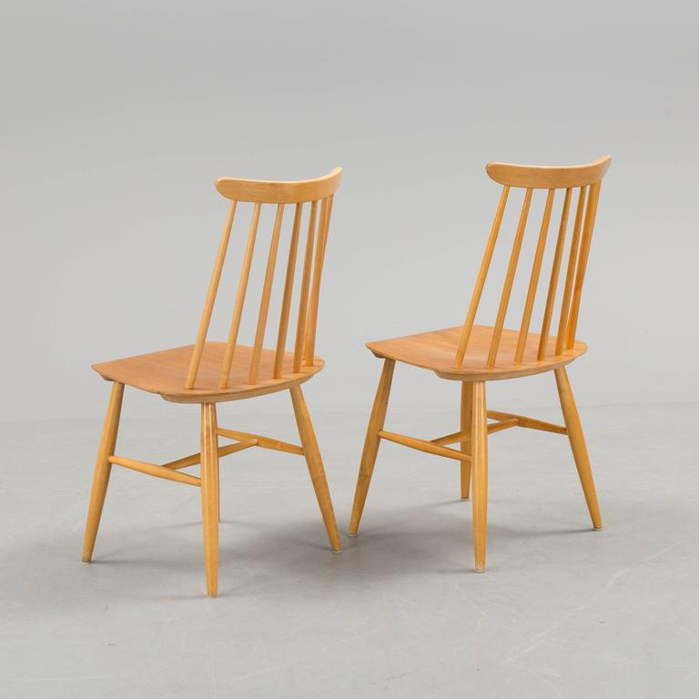 Birch construction with bent teak seat. Designed by Ilmari Tapiovaara in 1955 for Edsby-verken in Sweden. Perfect vintage condition. Signed Edsby.