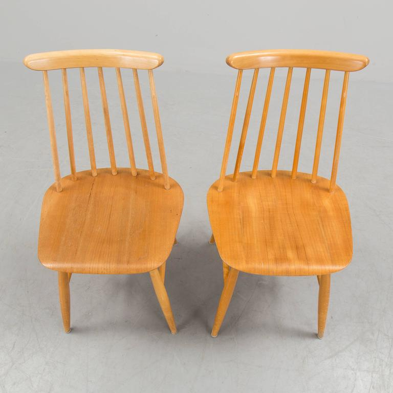Swedish Pair of Ilmari Tapiovaara Dining Chairs For Sale