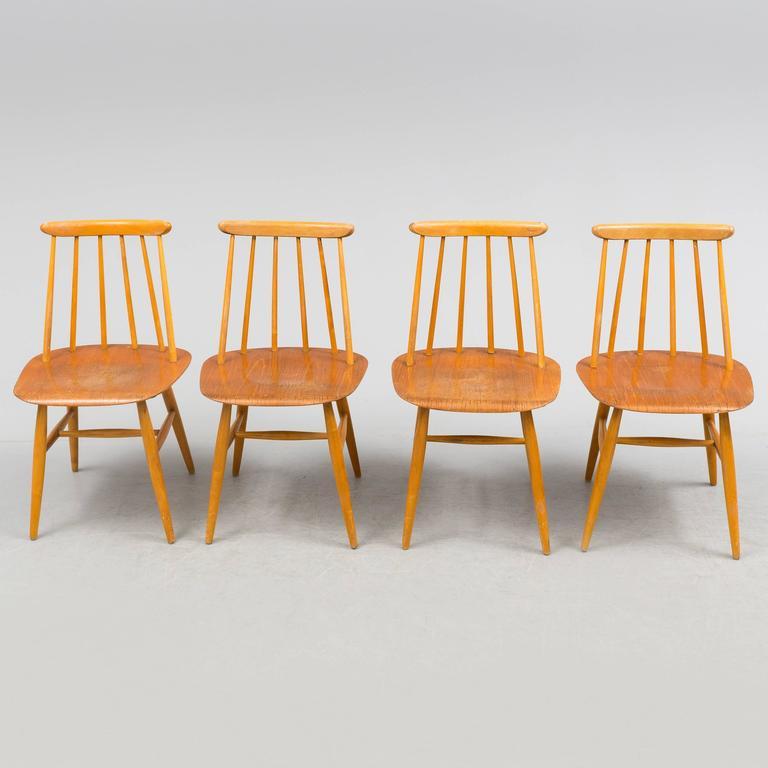 Birch construction with bent teak seat. Designed by Ilmari Tapiovaara in 1955 for Edsby-verken in Sweden, model Fanett 55 T. Perfect vintage condition. Signed Edsby.