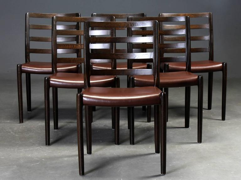Dining chairs in oak by Niels O. Møller for J.L. Moller. The model 85 chair is one of Moller's stoutest designs in their large variety of chair designs, perfect constructed chairs with great form. Designed in 1981, labelled underside. New (another)