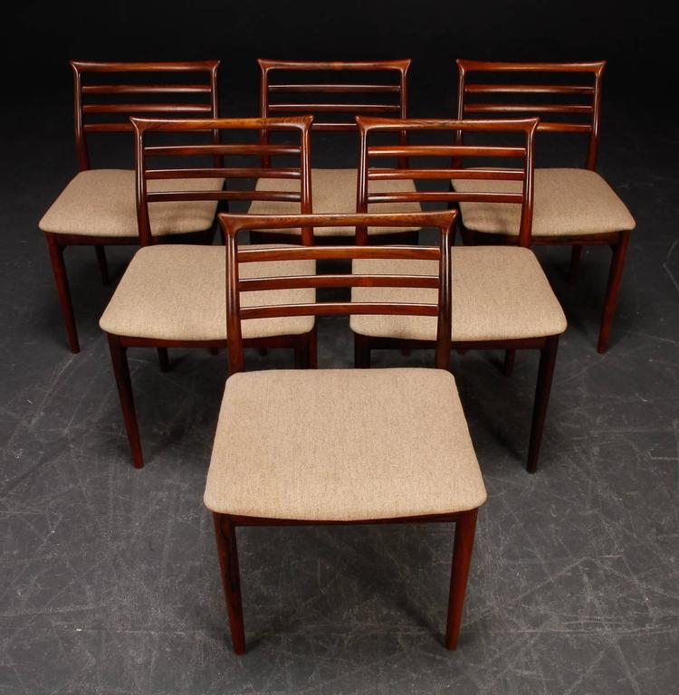 Dining chairs designed by Erling Torvits for Sorø stolefabrik in Denmark. Hand-sculpted solid hardwood. Wood and upholstery restored. Delivery time about 3-4 weeks!