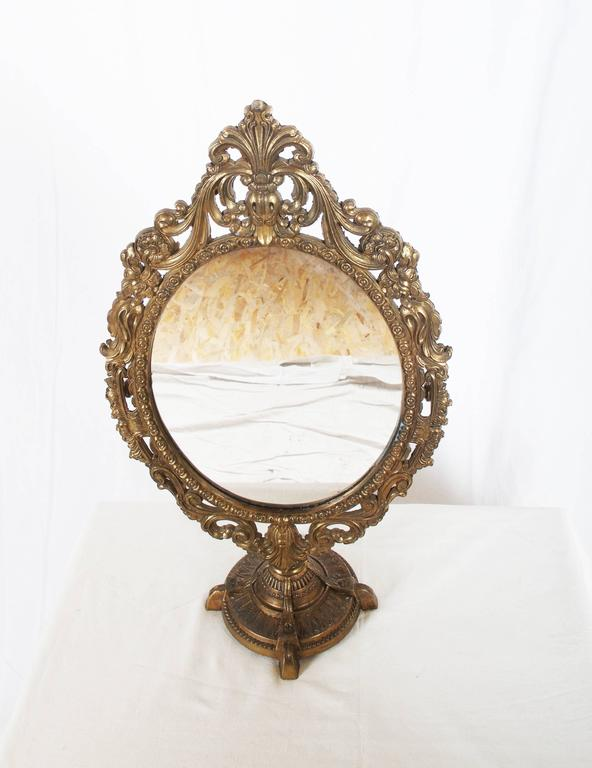 Oval table brass mirror in baroque style for sale at 1stdibs for Baroque oval mirror