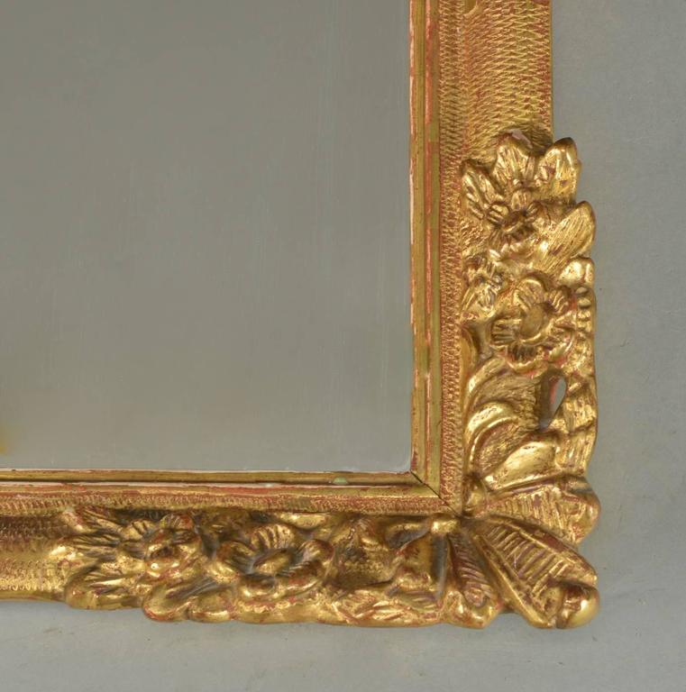 Mirror With Gold Plated Wood Frame And Flowers Decor At