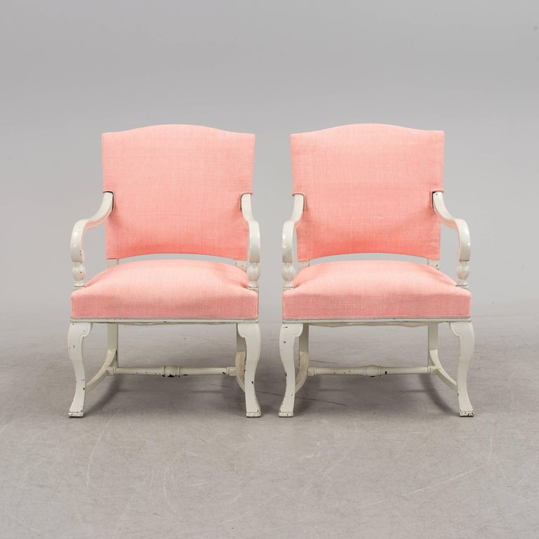 Wooden frame upholstered with pink fabric. Made in Sweden in circa 1890-1900.