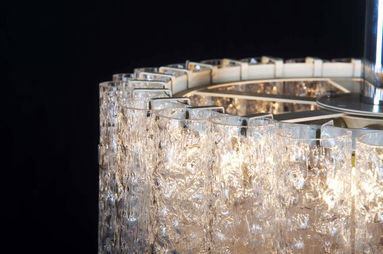 Spectacular pendant fixture by Doria Leuchten Germany from the 1970s composed of 27 individually handblown textured glass cylinders with