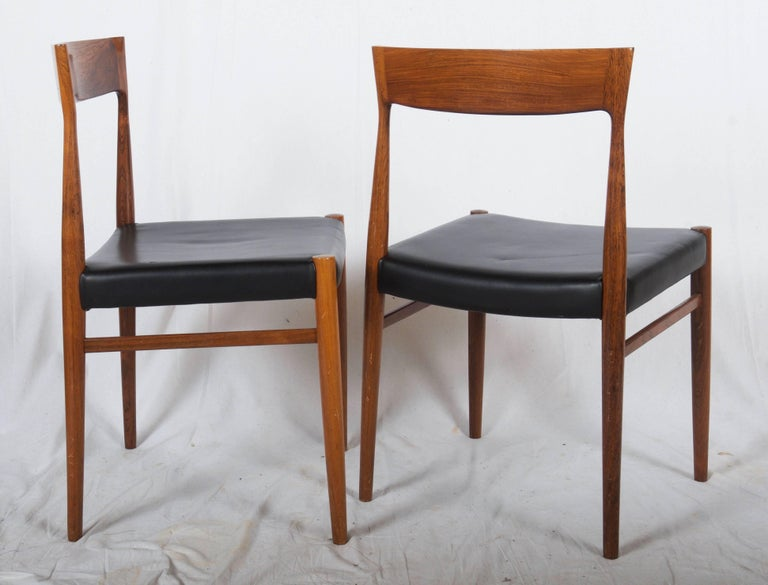 Hardwood frame, seat upholstered in synthetic leather, produced in Denmark in the 1960s. Construction is similar to Niels Otto Møller model 77 chairs. Wood in excellent condition, a new upholstery is of course on request possible in any kind of