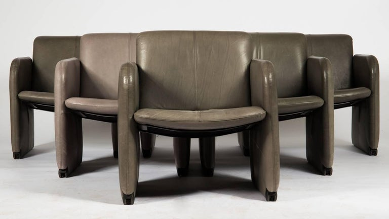 Steel/wood constuction covered with gray leather. Made in Germany by COR in the 1980s. 