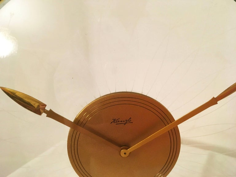 Kienzle table clock from the 1930s designed by Heinrich Möller. Brass with glass construction fitted with a mechanical movement.