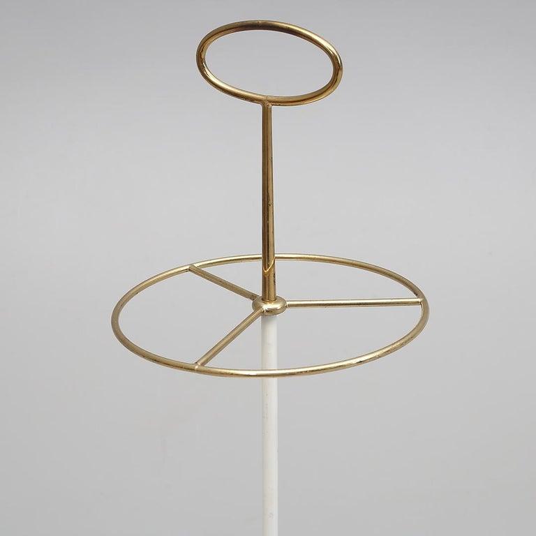 Cast iron foot with brass umbrella holder.