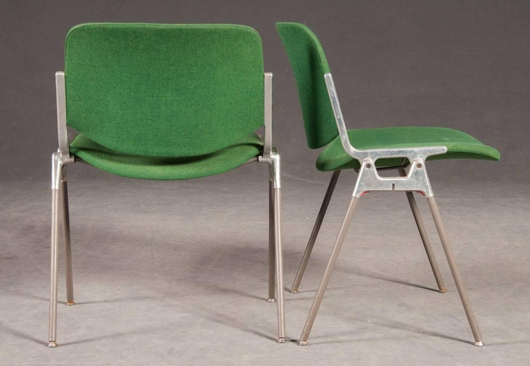 Frame made of cast aluminium frame, upholstered seat and back, covered with green fabric, still in original condition. Frame with patina and scratches. Upto 16 available.