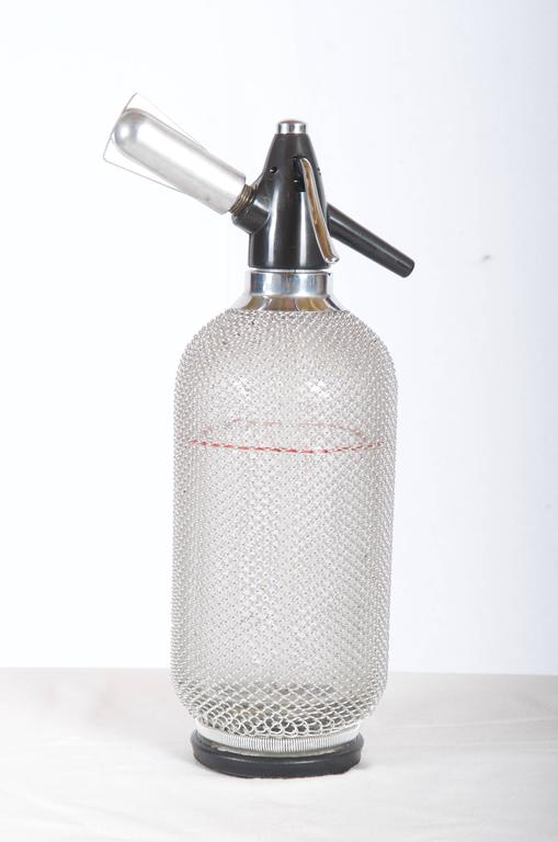 Late 20th Century Soda Siphon Seltzer Bottle with Wire Mesh Metal Around Glass For Sale