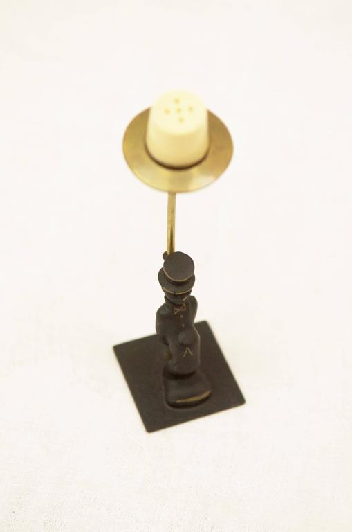 Brass salt shaker by Walter Bosse from the 1950s. The shaker is made from white plastic.