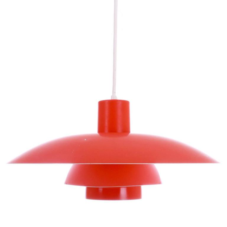 Classic orange pendant PH 4/3 by Poul Henningsen for Louis Poulsen originally designed in 1950s.