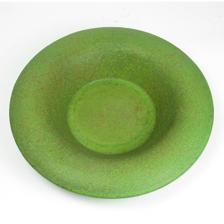 Unique Arts & Crafts period Mottled Matte green glazed ceramic shallow bowl with wide rim. Glaze appears similar to the cucumber matte green glazes of Hampshire Pottery (1883-1917) and Grueby Pottery. Unmarked. Diameter: 12 inches, height: 2 3/4