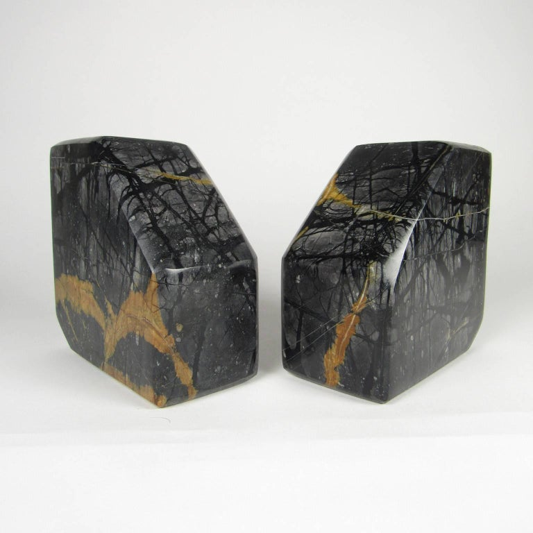 Pair of variegated black marble bookends.  Measures: 5 1/2 x 5 1/2 x 2 3/4 inches.