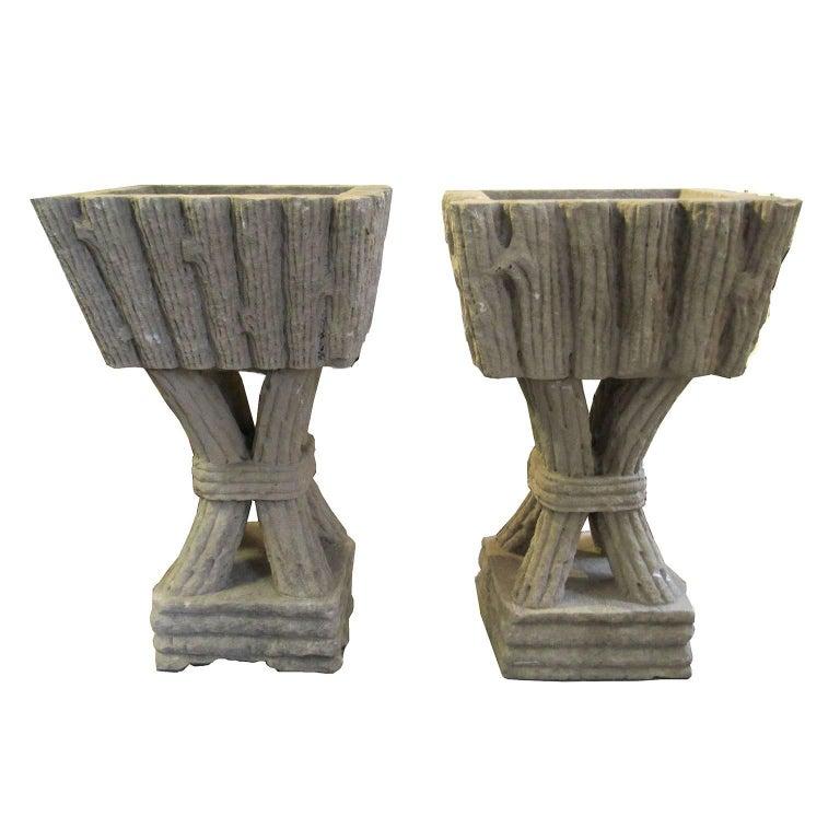 Massive pair of vintage faux bois pedestal form cast stone garden planters. Dimensions: 35 1/2 x 19 1/2 x 21 1/2 in.