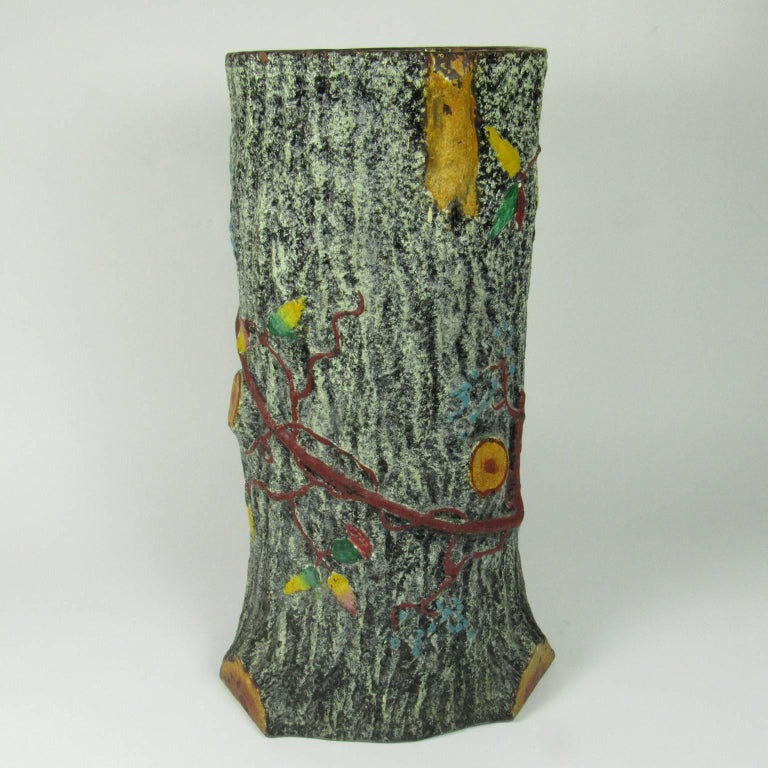 Vintage faux bois ceramic umbrella stand in the form of a tree trunk encrusted with a vine and fall leaves. Measures: Height: 19 in., diameter: 11 in. Provenance: Joel and Sharon Schwartz collection.