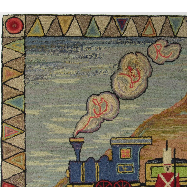 "American Folk Art ""Animal Train"" Hooked Rug, late 19th/early 20th century.  A whimsical rug perfect for a child's room or nursery, depicting a toy soldier standing in front of a train pulling cars filled with exotic animals through a"