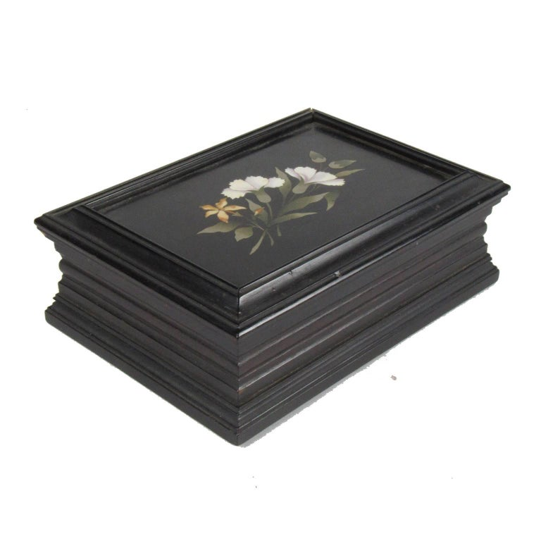 19th century Pietra Dura Ebonized Trinket Box.  Ebonized mahogany inlaid with marble.  Dimensions: 2 x 5 1/2 x 4 in.