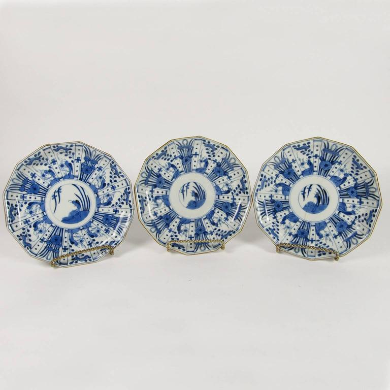 Set of six rare Japanese Ko-Imari blue and white porcelain plates, late 19th century, in the shape of a dodecagon (12 sides), with mark on bottom in underglaze blue. Diameter: 7 1/4 inches.
