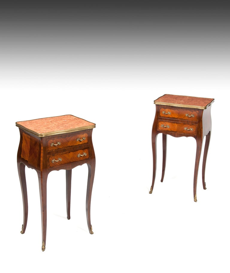 An elegant pair of finely constructed French rosewood and kingwood marble top beds cabinets.