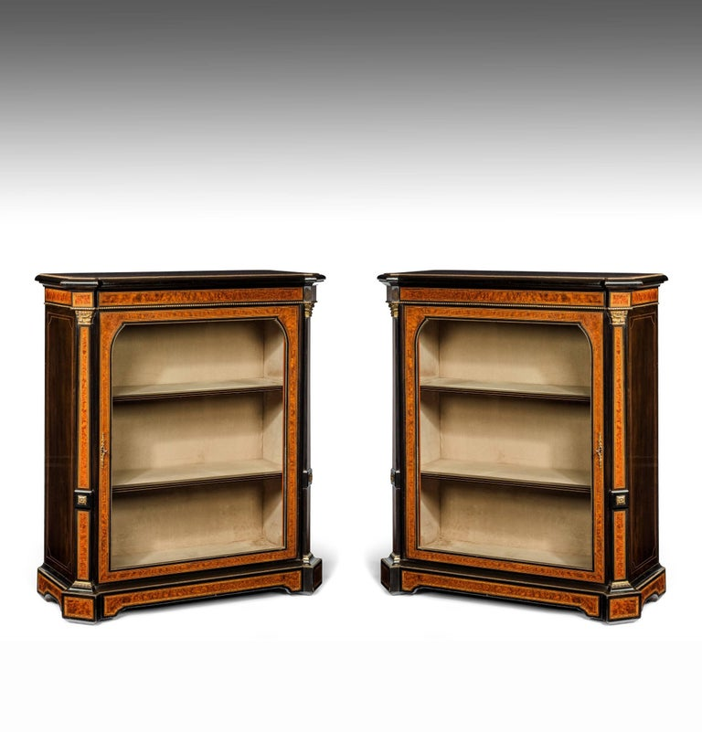 A delightful pair of ebonised amboyna and pollard oak inlaid pier cabinets dating to 1860. 