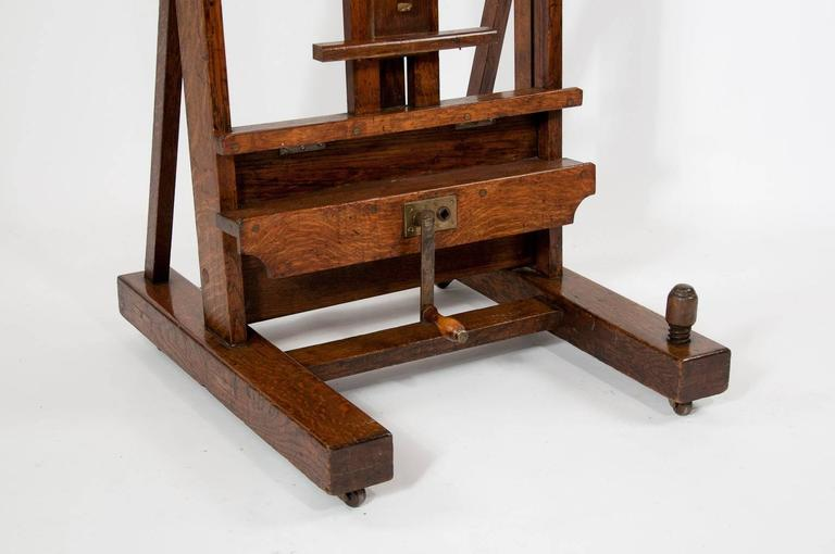A fantastic quality large oak studio easel by the famous firm Winsor and Newton from London. In lovely condition this large adjustable oak easel has it's original winding handle and makers plate inset