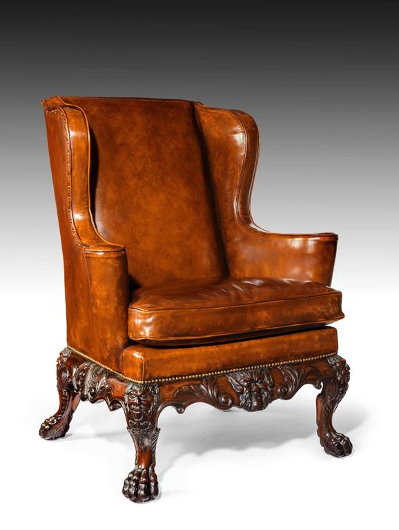 A Very Handsome And Well Carved Late Victorian Leather Upholstered Mahogany Wing  Back Armchair In The