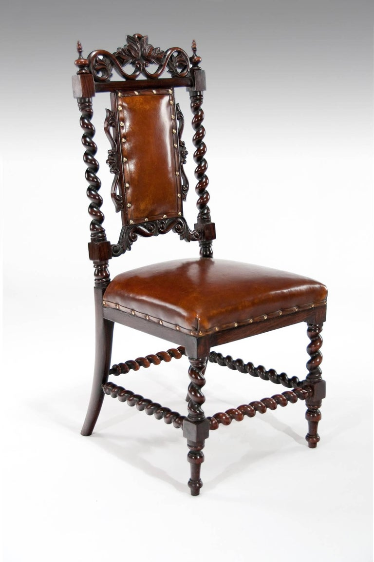 Good quality Victorian solid rosewood side chair upholstered in leather.  This attractive side chair has a pierced carved foliate scrolling top rail supported by barley twist columns and a padded leather and carved back.  The hand dyed leather