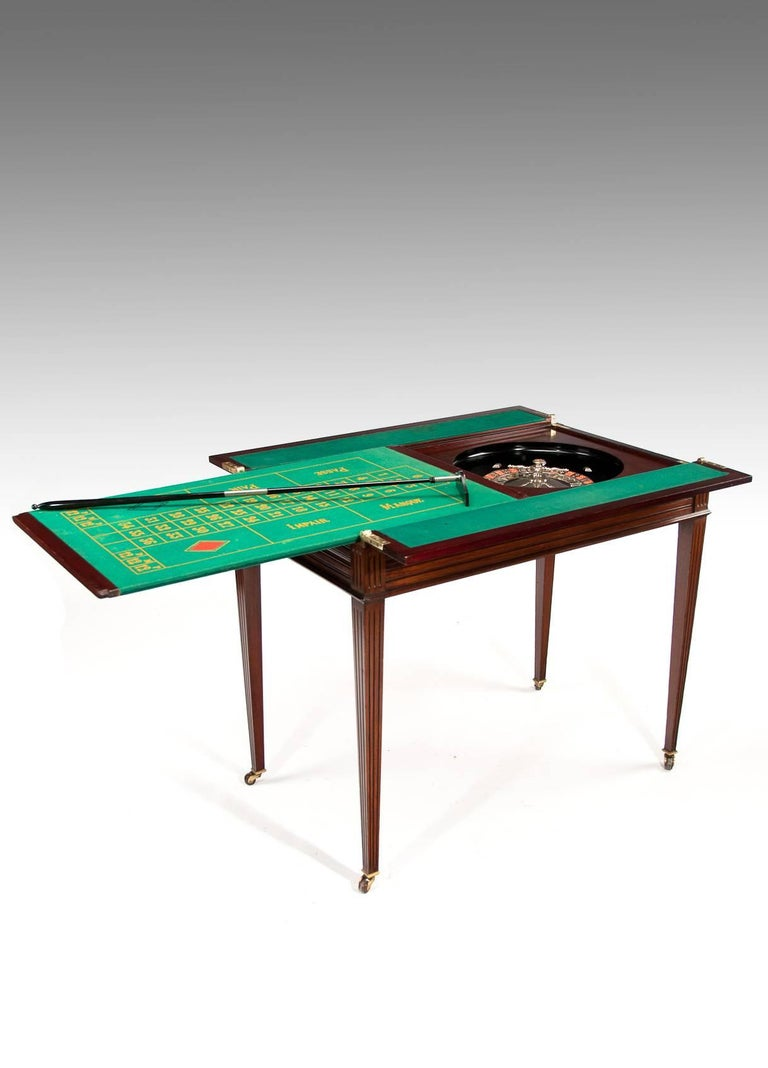 A Very Rare Edwardian Metamorphic Walnut Roulette Table Firmly Attributed To Maple And Co Of