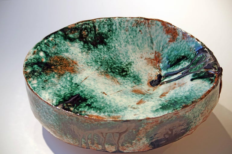 Contemporary ceramicist Brian Molanphy is inspired by the peaks and valleys seen on mountainous hikes. He plays with glazes and firing methods to create unique, contemporary end results that are different for each piece. This swell is formed from
