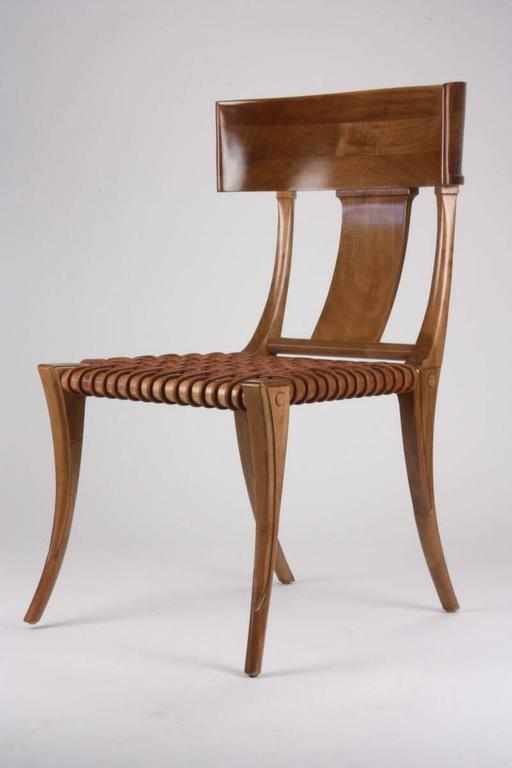 T.H Robsjohn-Gibbings for Saridis of Athens chair model No. 3. Made of Greek walnut. Back constructed with three pieces of walnut dowelled together. Corded leather seat. Cushion not included. Beautiful as a dining chair. 
