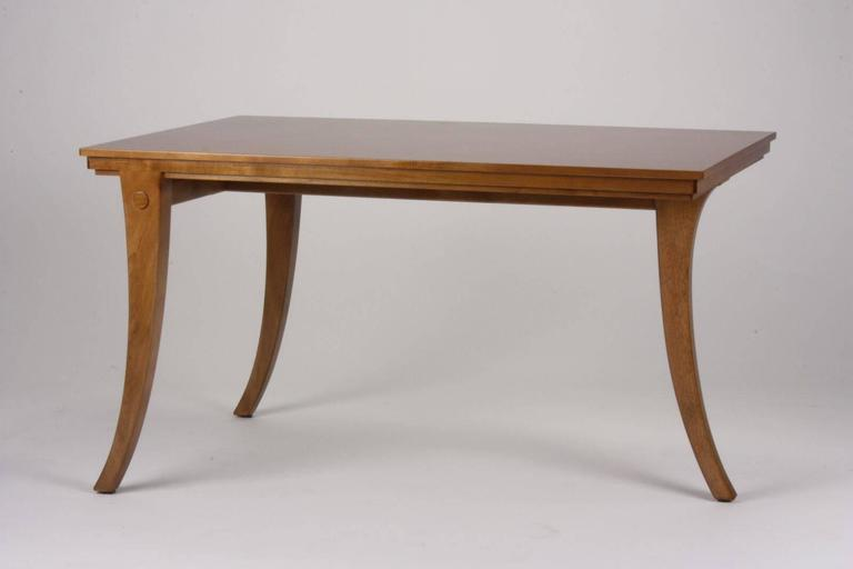 T.H Robsjohn-Gibbings for Saridis of Athens table Model No. 12. Made of Greek walnut with three legs joined by stretchers.  Each piece is custom ordered with a 90 day lead time.   Emily Summers Studio 54 is the exclusive dealer for Saridis of