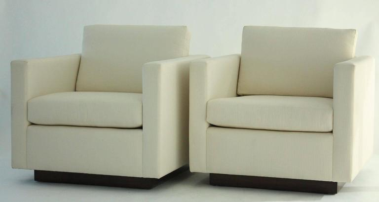 Pair of Nicos Zographos tuxedo lounge chairs. 1970s, USA. Recently reupholstered. Very good condition.